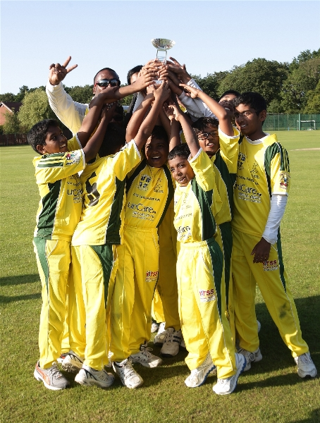 The team YTCA joniors under 11,with the trophy won against Philadelphia CC, on their ground in uk.